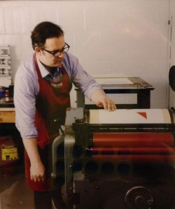 Maret printing a page from Interstices & Intersections on his Vandercook Universal III press.